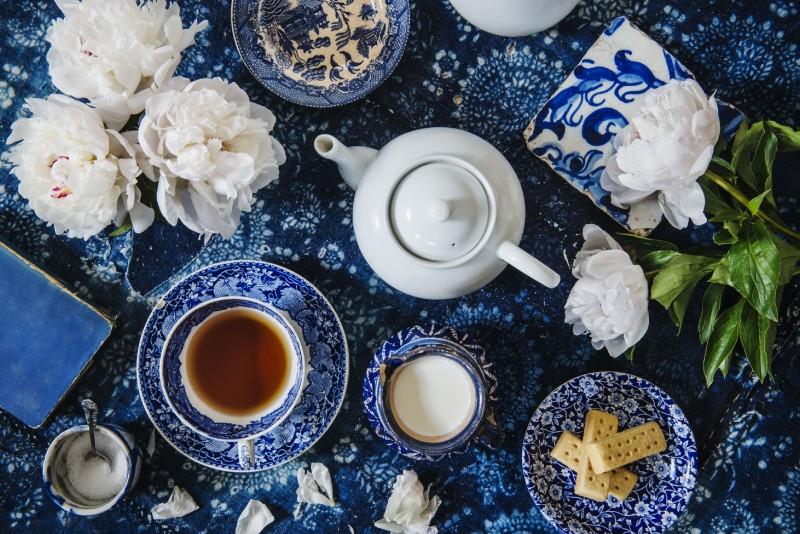 tea-setting-with-english-tea--flowers--biscuits--sugar--books-and-a-tea-pot-827102960-5ad4c04b04d1cf0037ec5b51.jpg