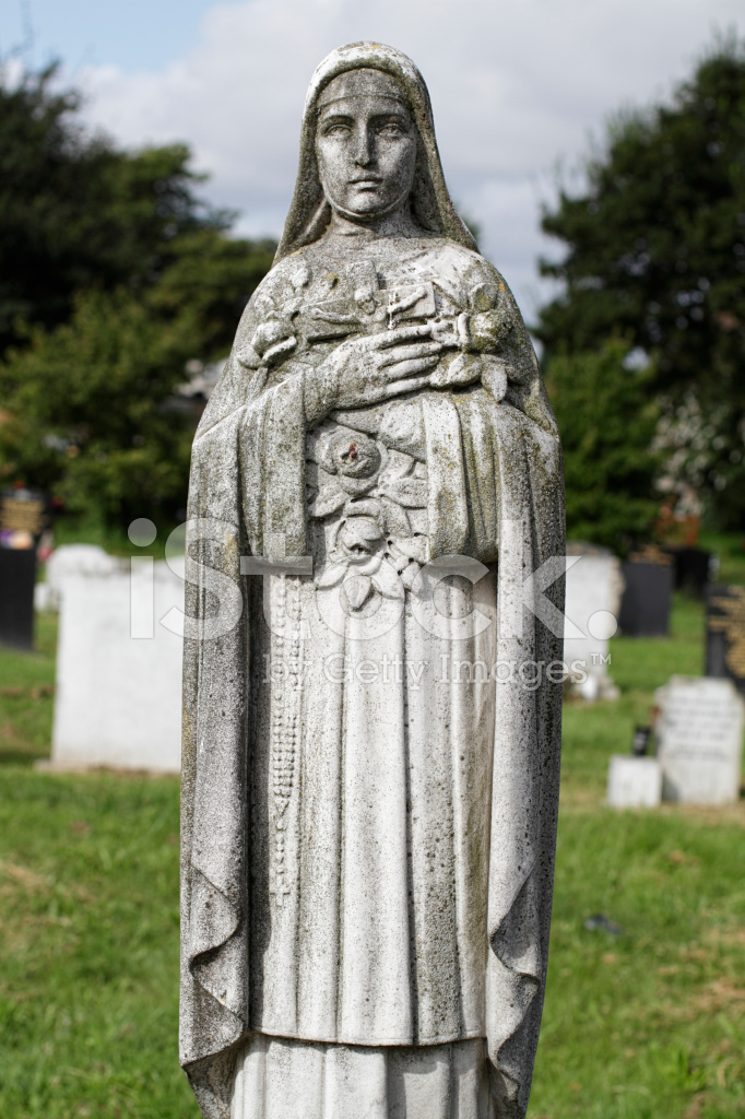 21202185-st-therese-of-lisieux-and-jesus-on-the-cross-statue.jpg